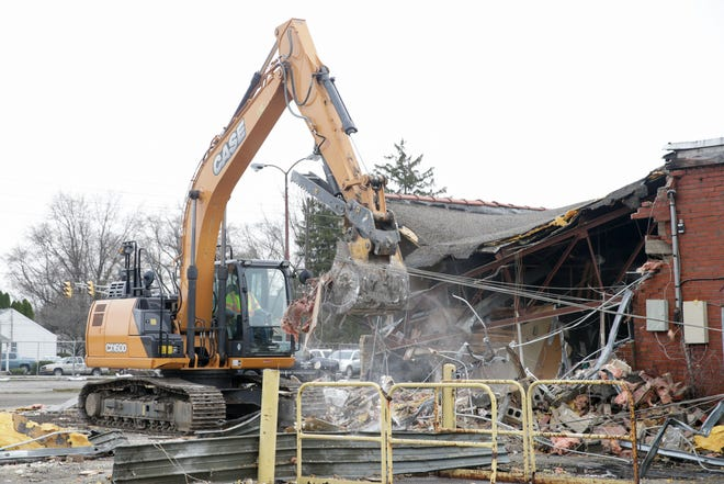An excavator demolishes a wall at the former Osco store at the corner of Kossuth and Main streets, Monday, April 8, 2019, in Lafayette. Once the store is demolished, the city plans on converting the site into a parking lot with easy access to Loeb Stadium.