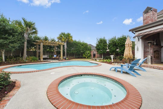 The pool area is a backyard paradise.