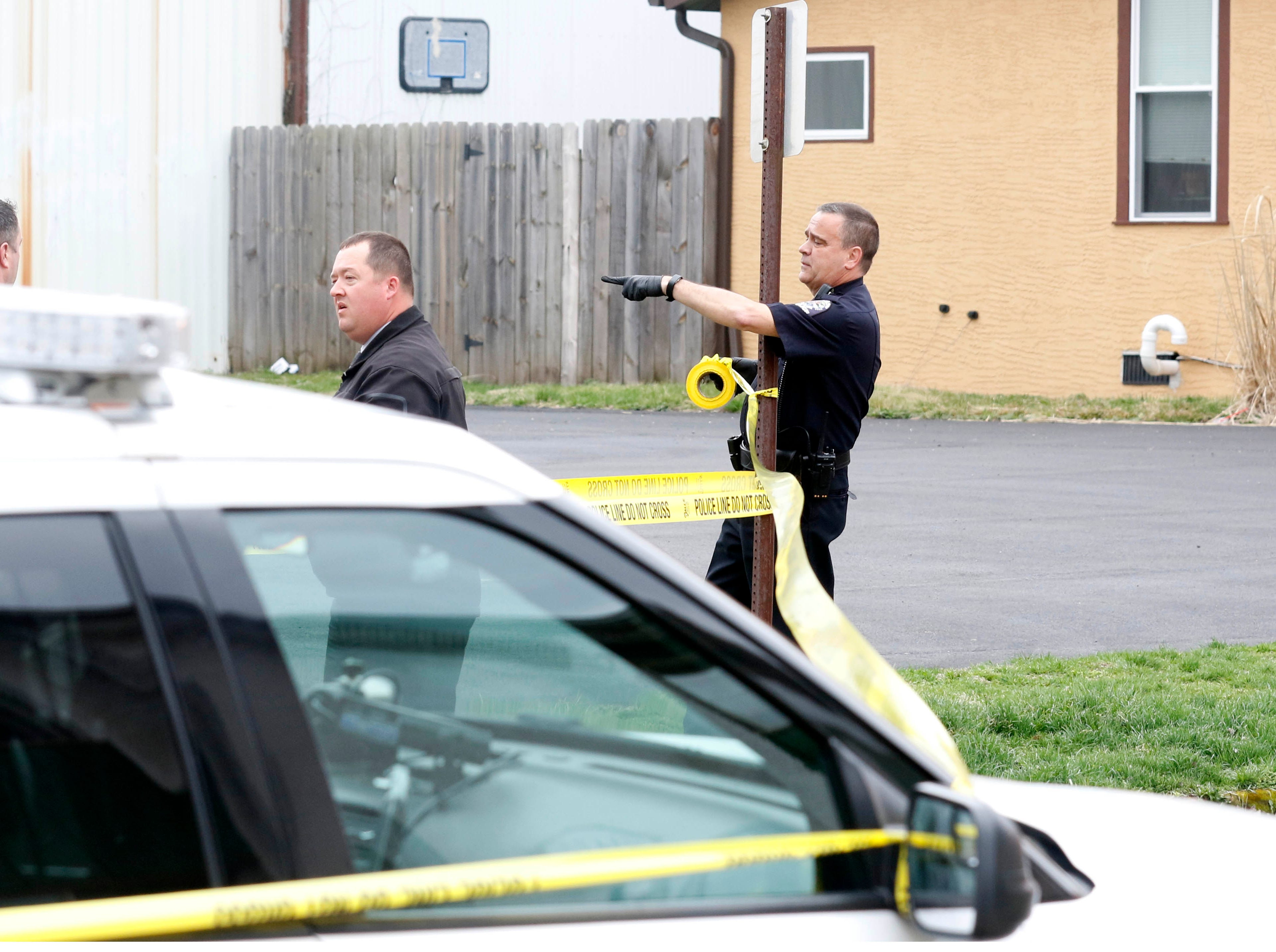 Lancaster police officers tape off West Walnut Street as they investigate a stabbing at an apartment building Monday morning, April 8, 2019, in downtown Lancaster. One man died in the stabbing.