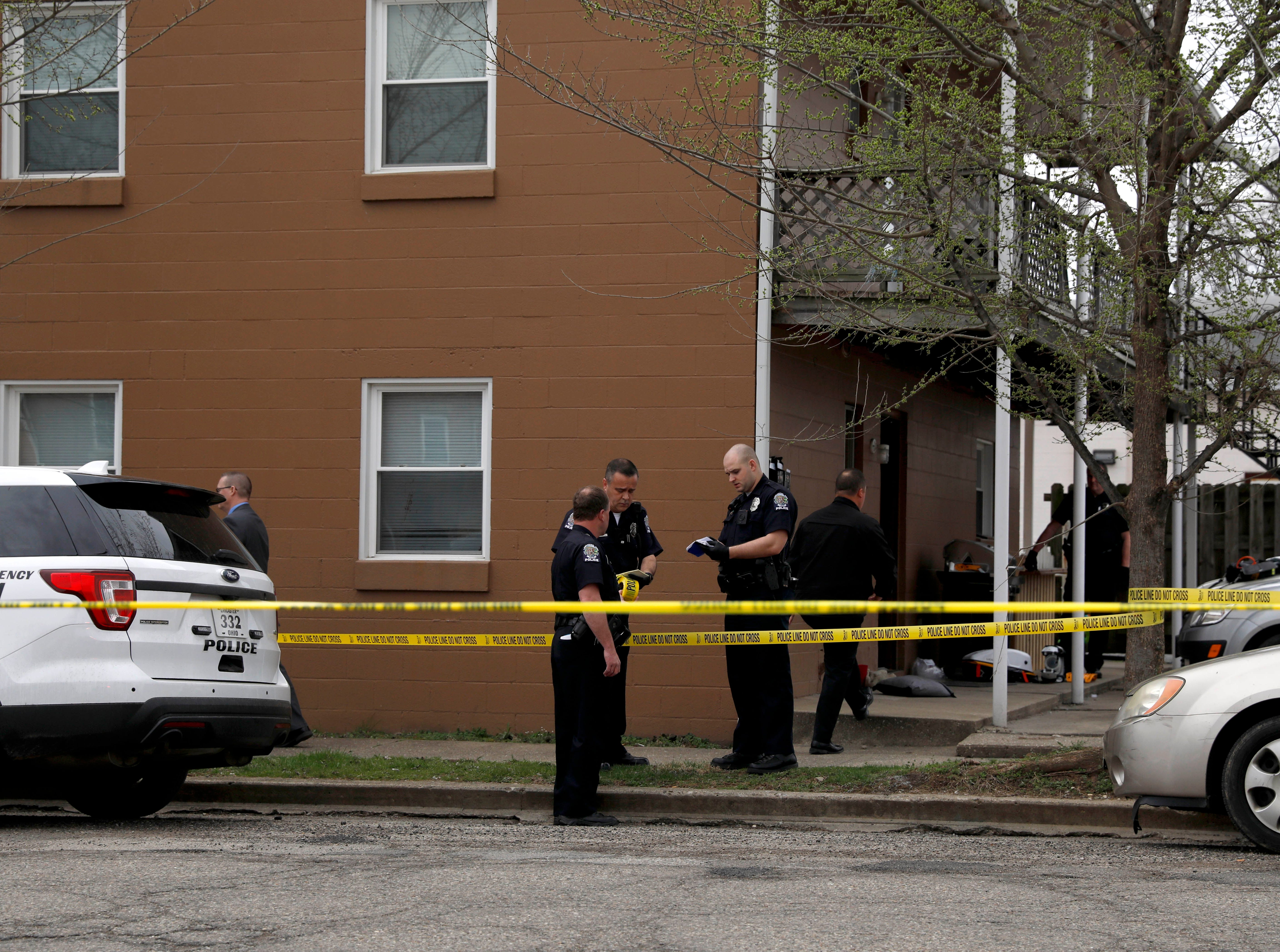 Lancaster police officers investigate a stabbing at an apartment building Monday morning, April 8, 2019, in downtown Lancaster. One man died in the stabbing.