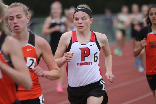 Pinckney's Noelle Adriaens (6) won the New Balance Nationals Indoor 5,000-meter race.