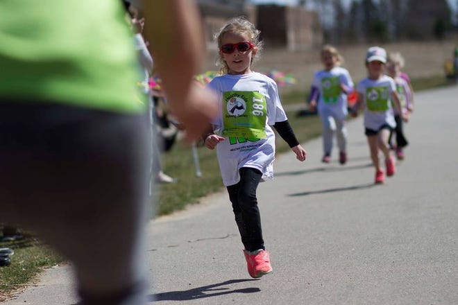 Piper Desilets, 5, runs during a 2018 Healthy Kids Running race.