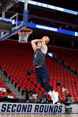 Bucknell Bison forward Nate Sestina (4) dunks the ball during the practice day before the first round of the 2018 NCAA Tournament at Little Caesars Arena.