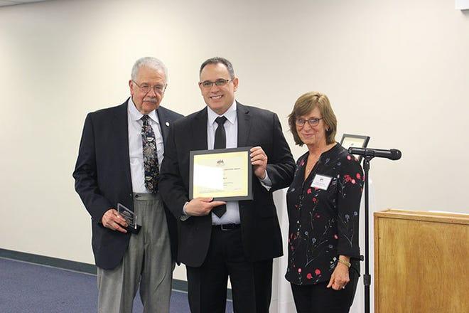 Felix Chalu (middle) awarded one of the Lansing Latino Health Alliance's 2018 Outstanding Hispanic/Latino Caregivers.