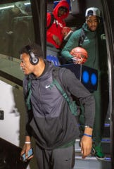 MSU Spartan basketball players Kenny Goins, Nick Ward, and Brock Washington disembark bus on return from Final Four Playoffs, Monday, April 8, 2019, at MSU Breslin Center.