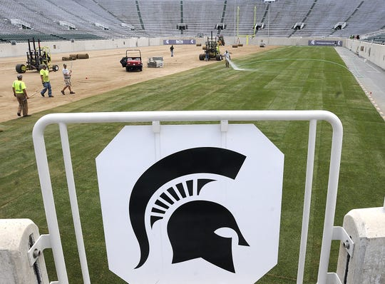 This 2011 photo shows crews installing turfgrass at Spartan Stadium. The Kentucky bluegrass will be removed and replaced with new grass this month.