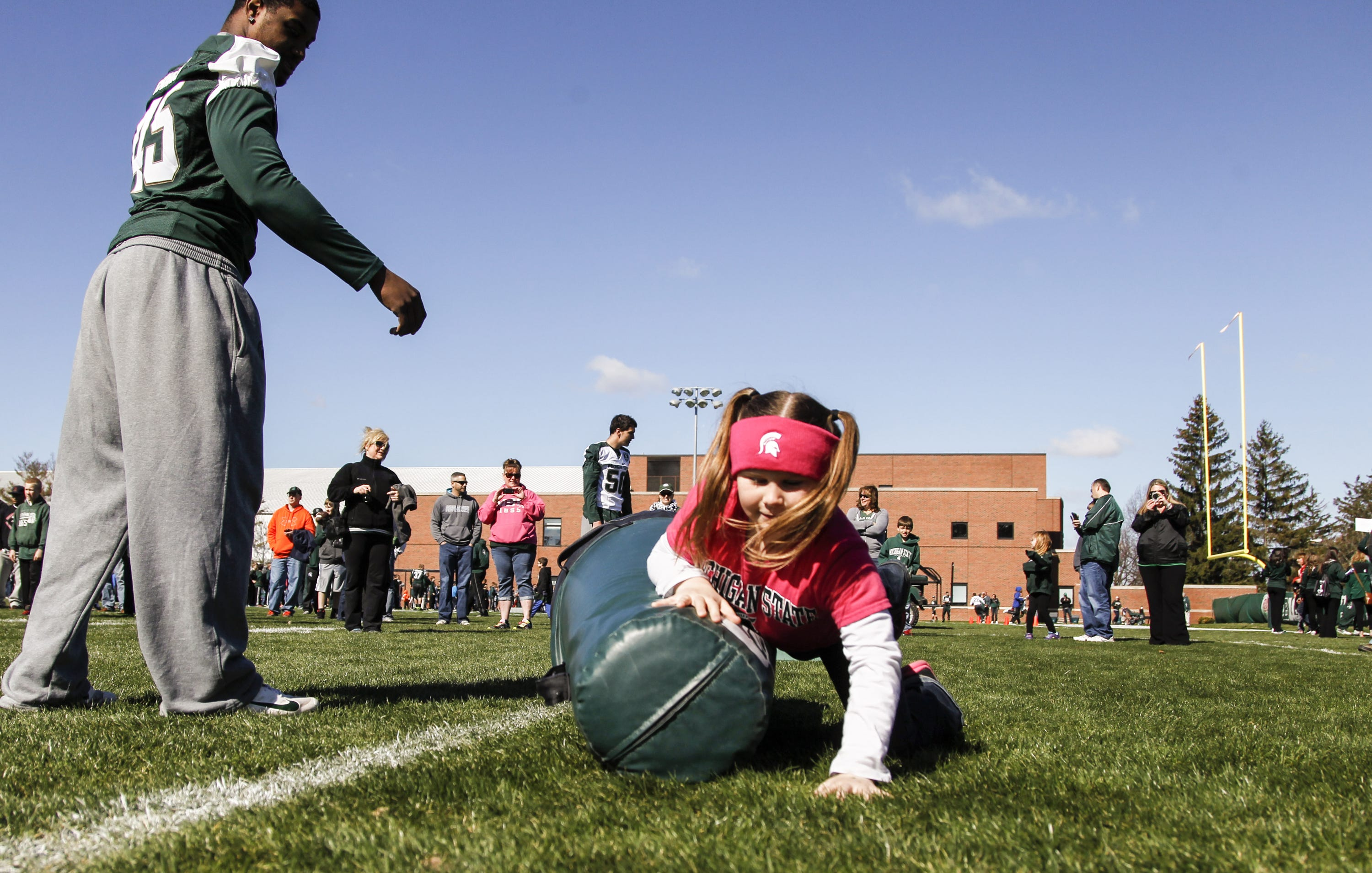 Natalie Edlmisten, of Elkhart, Indiana, participated in agility drills before the MSU football team's spring game in 2014. She was 8 at the time.