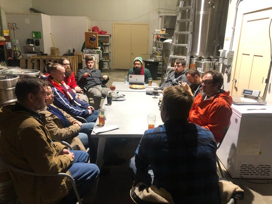 Members of the Assembly Line, the supporter's group for Lansing Ignite Football Club, meet at Ozone's Brewhouse on Friday, Jan. 25.