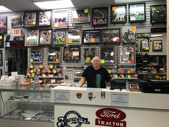 Al Kieffer, owner of Sports Scene in the Marshfield Mall, poses in his store Monday, April 8, 2019.