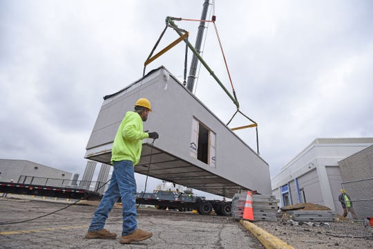 Delivery of a new MRI unit at Avita Hospital was craned into position on the west side of the hospital at the Richland Mall on Monday morning.