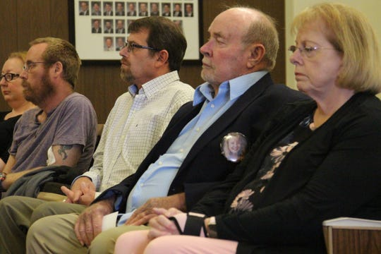 Ted Travis sits with his family inside a Marion County courtroom Monday afternoon as the man convicted of killing and raping his pregnant daughter Robin Dennis in 1993 is given a new sentence.