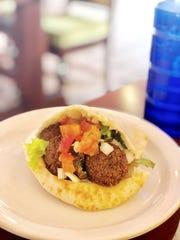 "The falafel ""Big Mac of the Middle East"" pita sandwich at Casabanca."