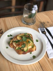 Avocado Toast with a fried egg at Inspire Community Cafe.