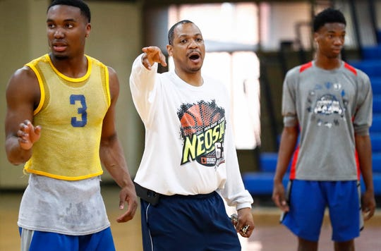 West Memphis coach Marcus Brown (middle) runs the players through drills during a recent practice.