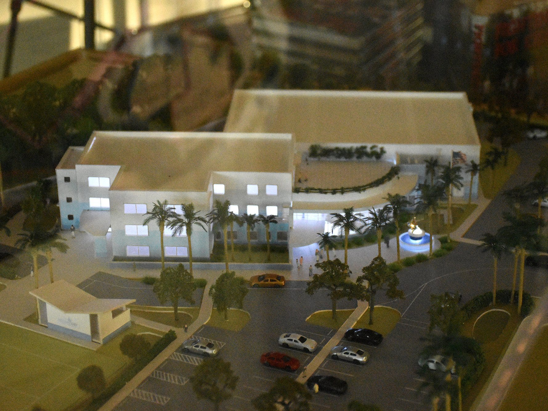 The newly unveiled architect's model lights up beneath its plexiglass housing. Marco Island Academy held 'Cheers for Champions,' a benefit dinner to raise funds for the school's athletic programs, Saturday evening at Hideaway Beach Club.
