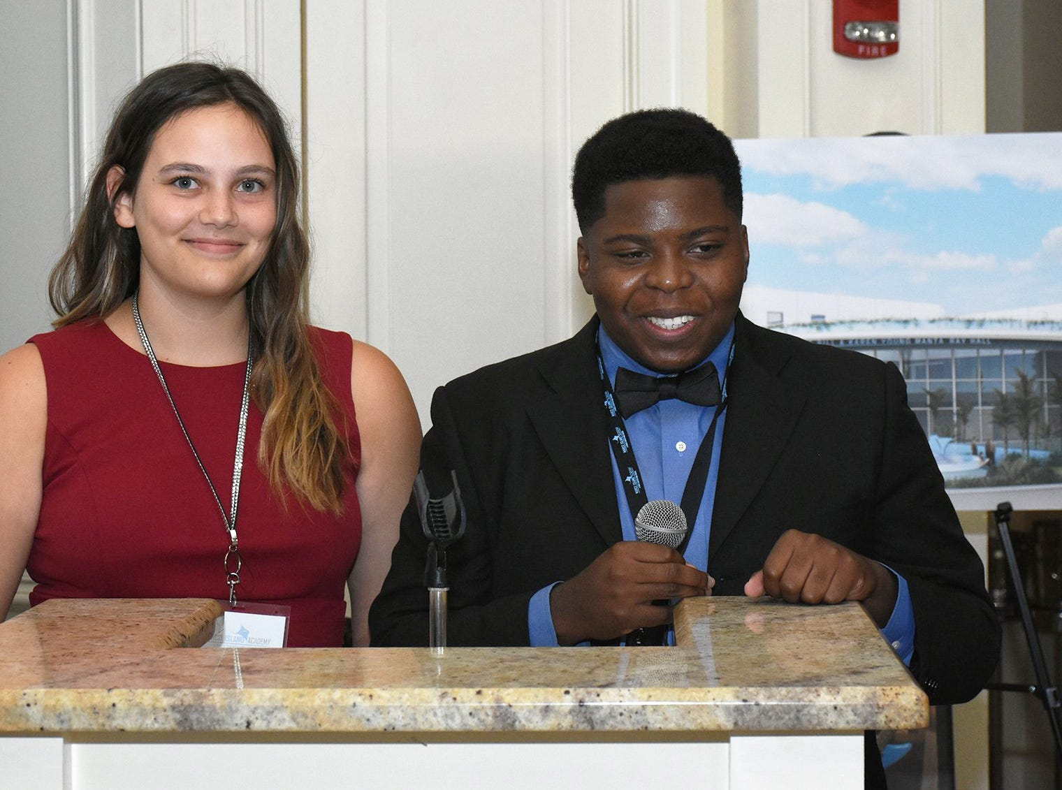 Student athletes Nicole Brunson and Evans Metelus serve as co-hosts. Marco Island Academy held 'Cheers for Champions,' a benefit dinner to raise funds for the school's athletic programs, Saturday evening at Hideaway Beach Club.