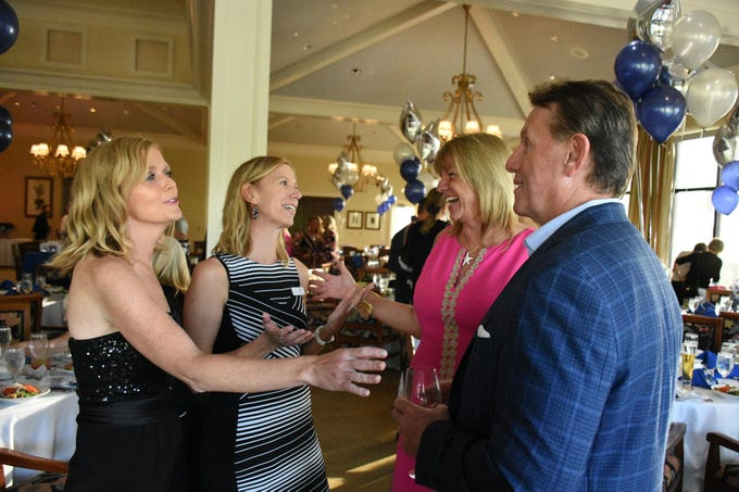 MIA Principal Melissa Scott, from left, and founder Jane Watt speak with Sharon and John Lockwood of Marriott. Marco Island Academy held 'Cheers for Champions,' a benefit dinner to raise funds for the school's athletic programs, Saturday evening at Hideaway Beach Club.