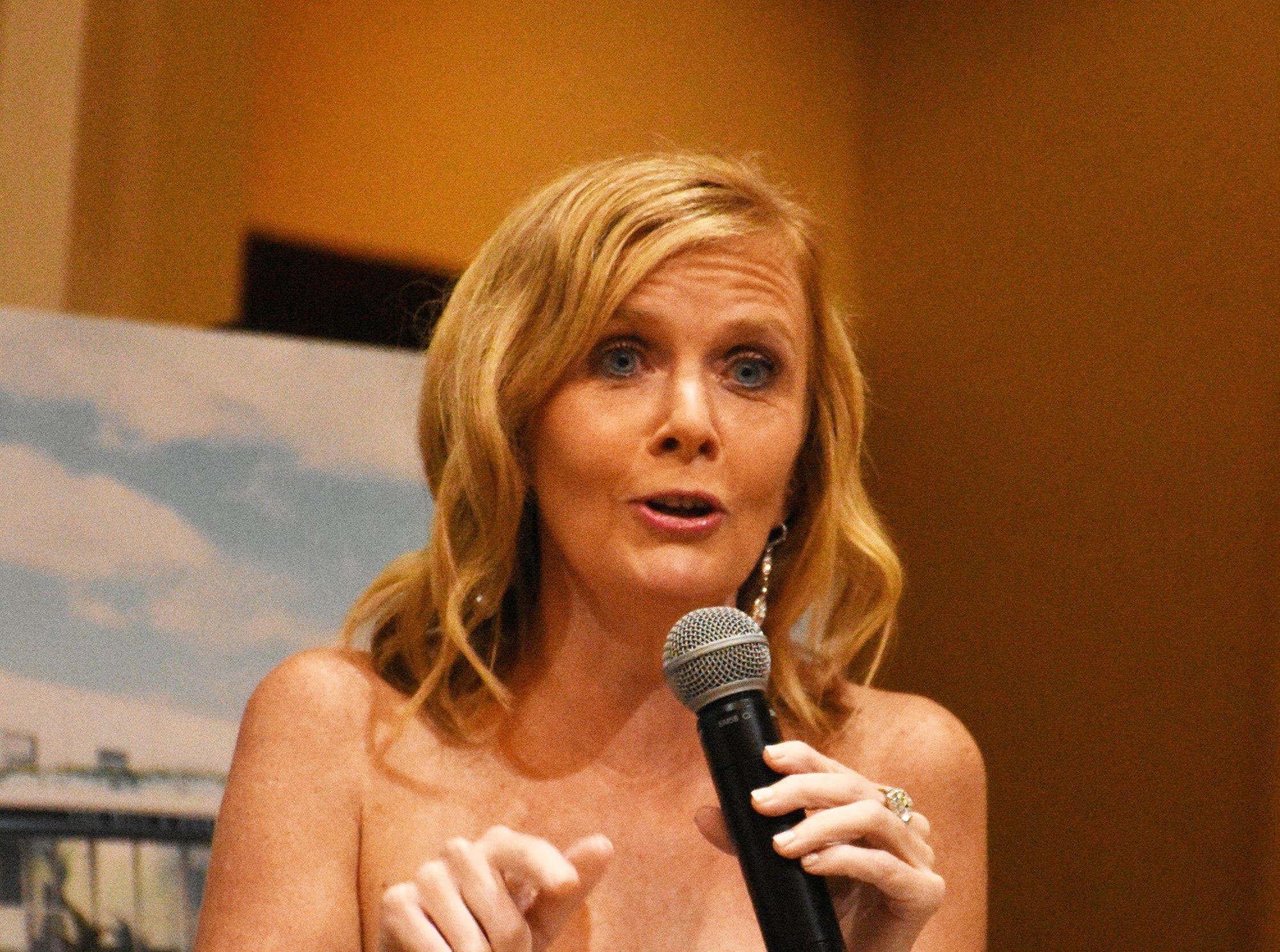 MIA Principal Melissa Scott pitches for contributions. Marco Island Academy held 'Cheers for Champions,' a benefit dinner to raise funds for the school's athletic programs, Saturday evening at Hideaway Beach Club.
