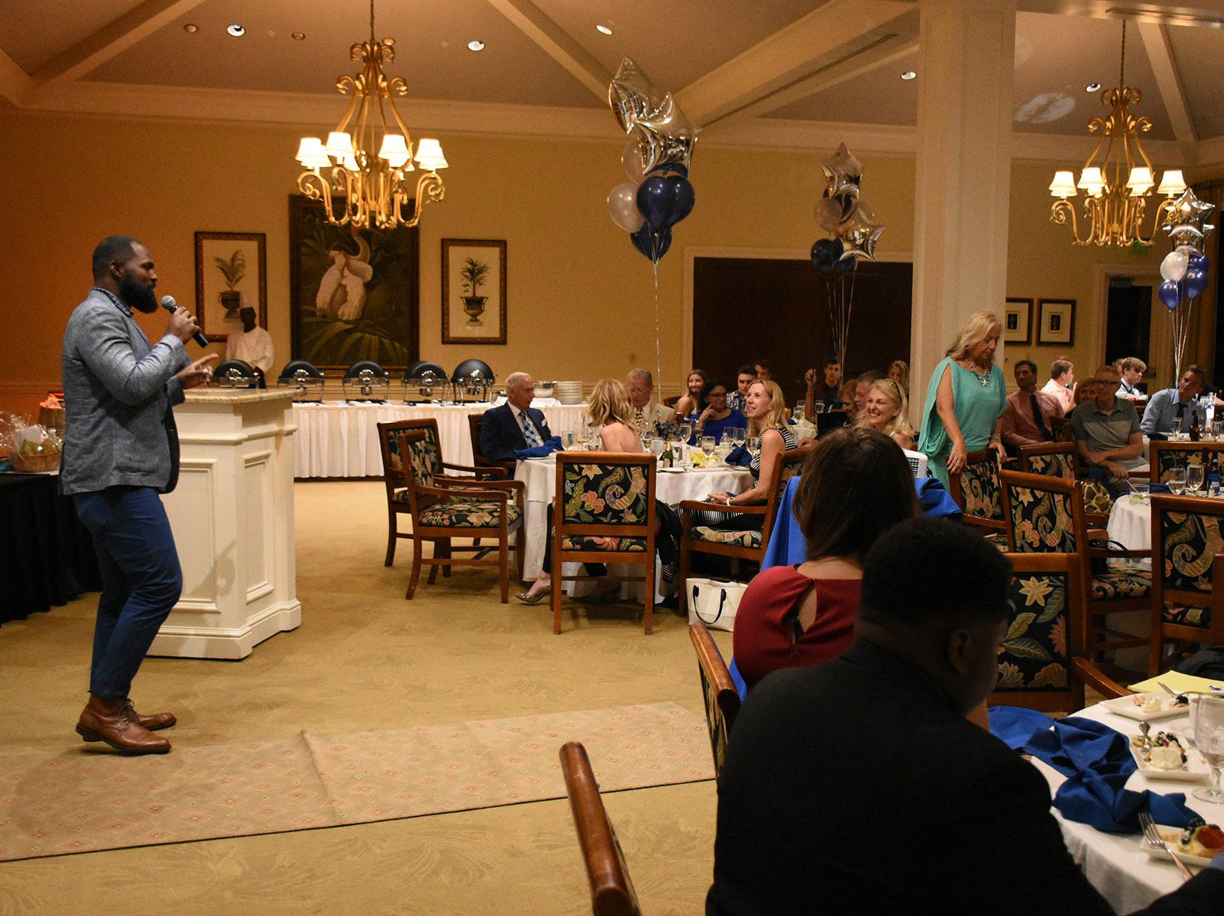 Guest speaker Andre Fluellen, a former NFL player, gives the keynote address. Marco Island Academy held 'Cheers for Champions,' a benefit dinner to raise funds for the school's athletic programs, Saturday evening at Hideaway Beach Club.