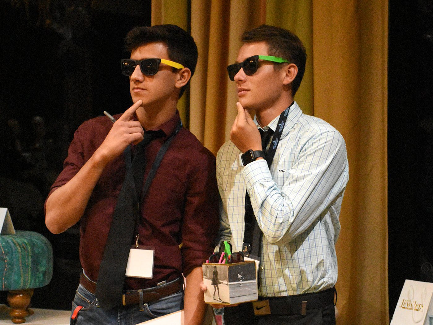 Student spotters Tristan Arroyave, left, and Garrett Chamberlain watch for paddles going up during the call to action. Marco Island Academy held 'Cheers for Champions,' a benefit dinner to raise funds for the school's athletic programs, Saturday evening at Hideaway Beach Club.