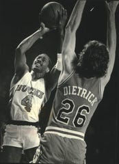 Sidney Moncrief shot between the Bulls' Ricky Sobers (left) and Coby Dietrick.