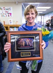 Marcy Elementary School Principal Michele Trawicki displays a plaque she received after being named the 2019 Wisconsin Elementary School Principal of the Year by the Association of Wisconsin School Administrators (AWSA) at the school in Menomonee Falls on Friday, April 5, 2019.