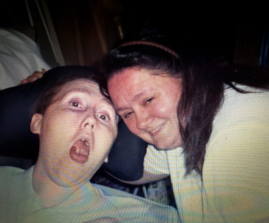 Kathleen Kirton is shown with her son, Tim. After his near drowning and brain damage in 1992, she cared for him at home until he needed to be moved into institutional settings.