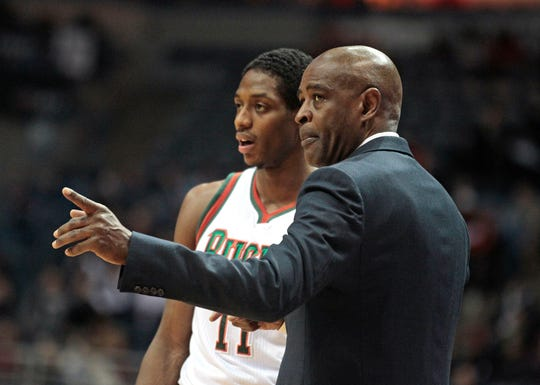 Milwaukee Bucks head coach Larry Drew talks with Milwaukee Bucks point guard Brandon Knight (11) during a timeout during the NBA basketball game between the Milwaukee Bucks and the  Phoenix Suns at the BMO Harris Bradley Center in Milwaukee, Wisconsin, Wednesday, January 29, 2014. Knight and Drew had very short-lived tenures in Milwaukee.