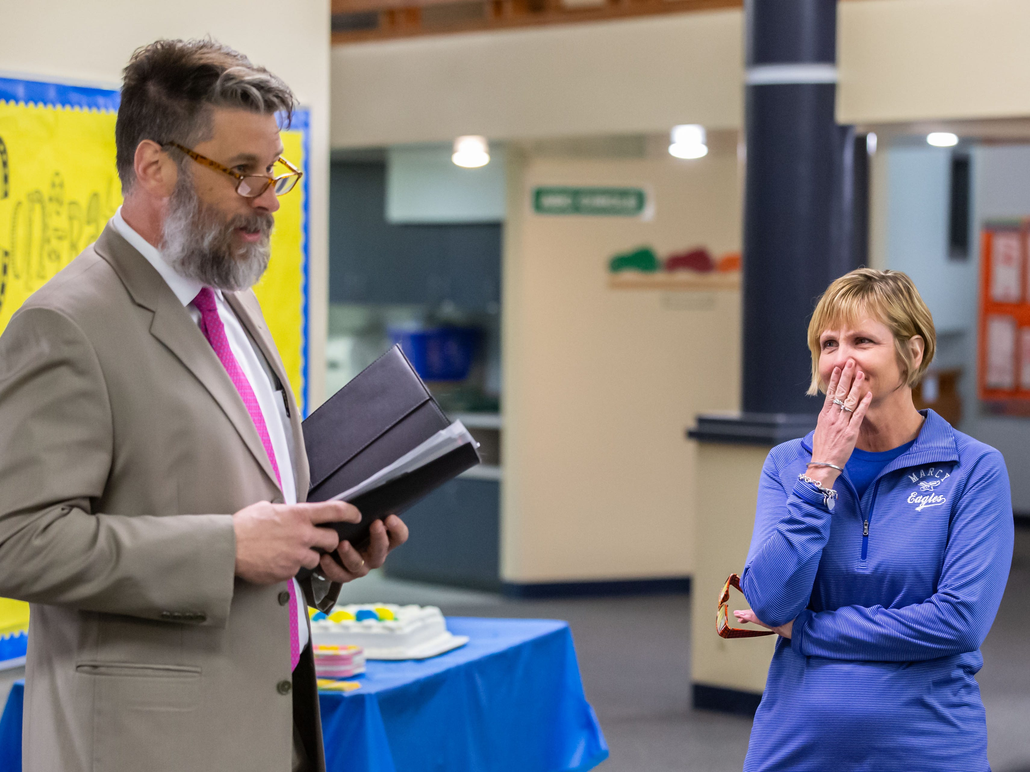 AWSA President Rick Flaherty surprises Marcy Elementary School Principal Michele Trawicki with the 2019 Wisconsin Elementary School Principal of the Year award from the Association of Wisconsin School Administrators (AWSA) at Marcy Elementary School in Menomonee Falls on Friday, April 5, 2019.