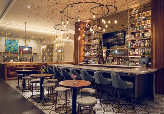 The bar at the Sophy is a hangout spot for local Hyde Park residents and hotel guests.