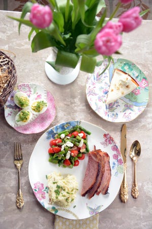 Deviled eggs, ham, mashed potatoes, asparagus salad and a carrot cake cheesecake for dessert makes a very special Easter meal.