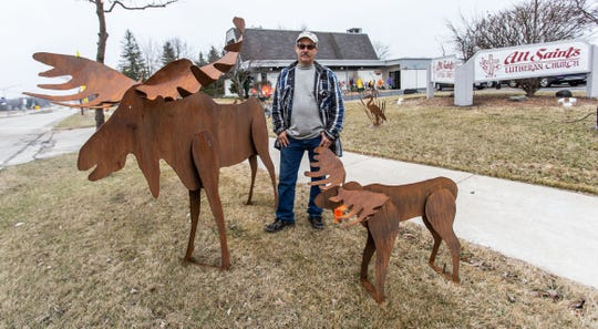 Artist Greg Millard of Oak Creek stands with several of his large metal sculptures during the annual craft fair at All Saint's Church in Oak Creek on Saturday, April 6, 2019. Greg is retiring after years of selling his artwork at the fair.