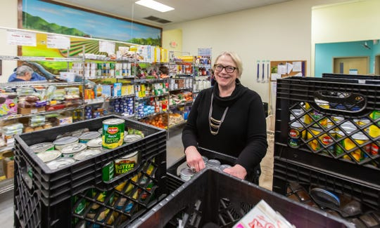 Executive Director Karen Tredwell oversees operations at the Food Pantry of Waukesha on Thursday, April 4.