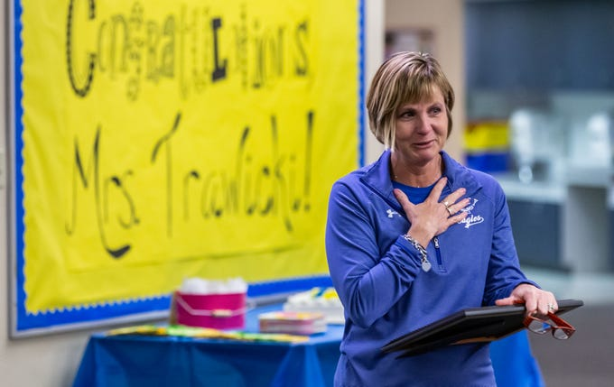 Marcy Elementary School Principal Michele Trawicki credits her staff after a surprise announcement that she was named the 2019 Wisconsin Elementary School Principal of the Year by the Association of Wisconsin School Administrators (AWSA) at the school in Menomonee Falls on Friday, April 5, 2019.