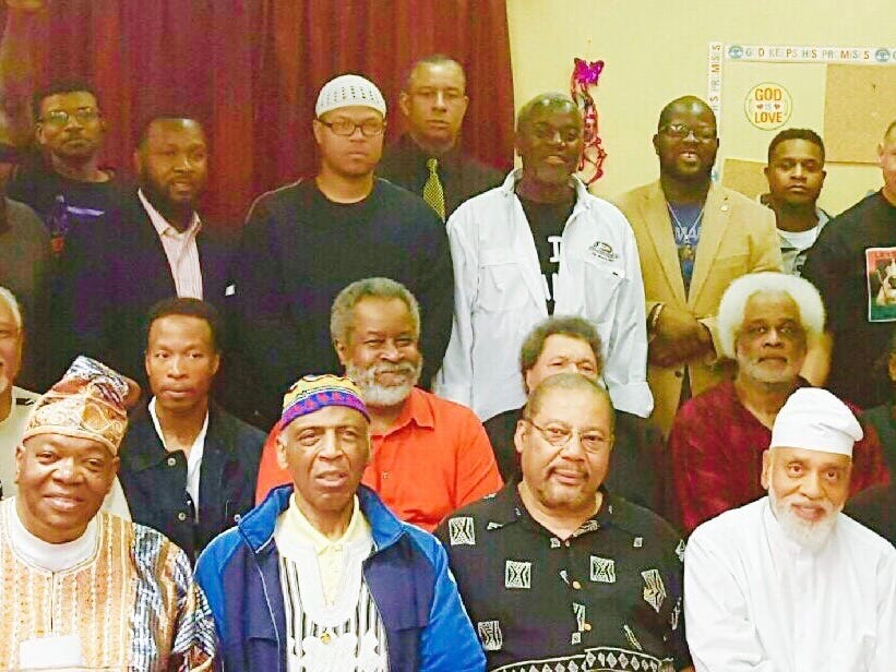 Gregory Stanford (second row, third from left) is pictured with a number of black community activists during a ceremony to honor Taki S. Raton, who died in June 2015. Raton was an educator who believed in self-reliance.