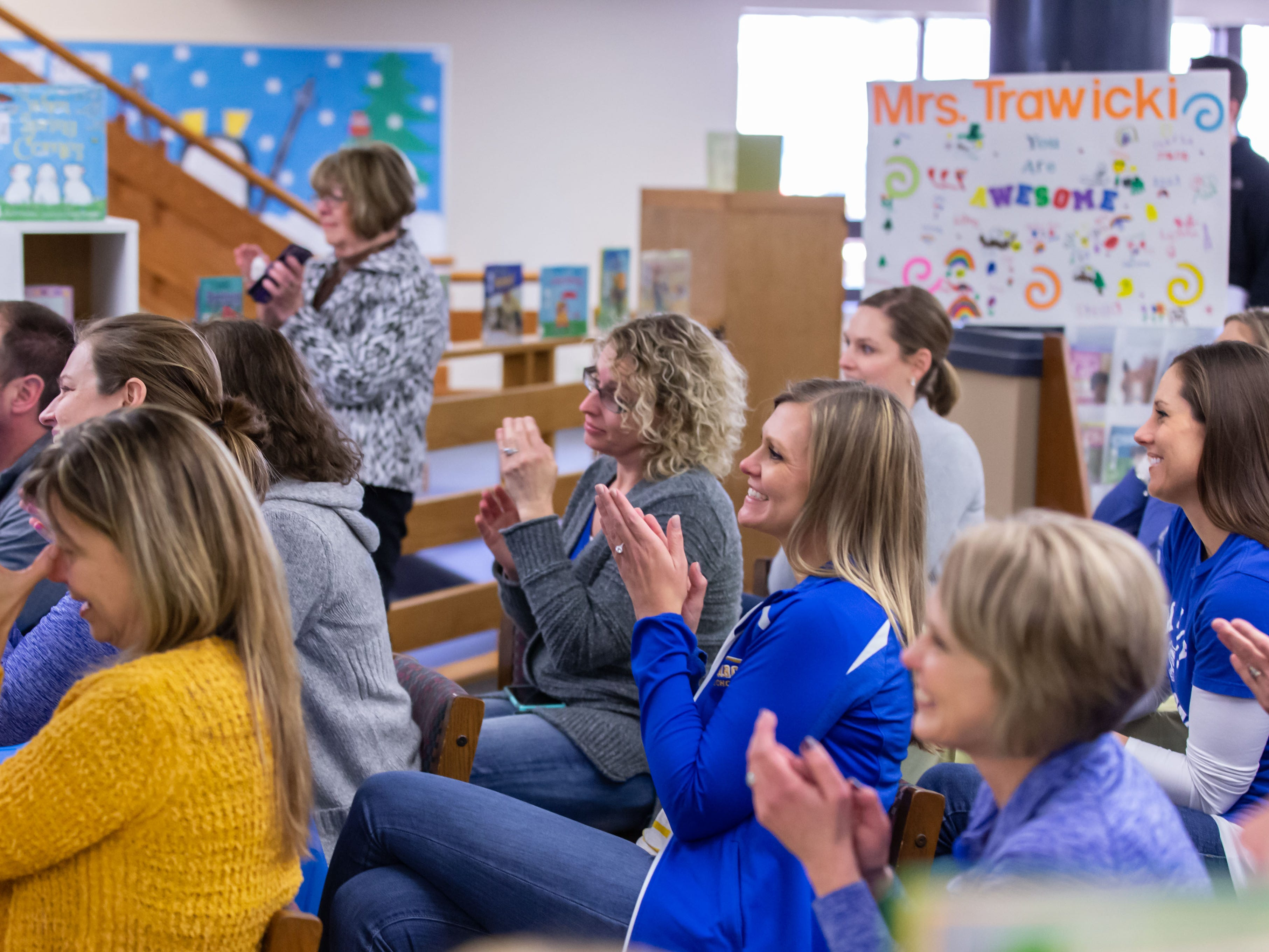 Marcy Elementary School staff members applaud as their Principal, Michele Trawicki, is named the 2019 Wisconsin Elementary School Principal of the Year by the Association of Wisconsin School Administrators (AWSA) on Friday, April 5, 2019.