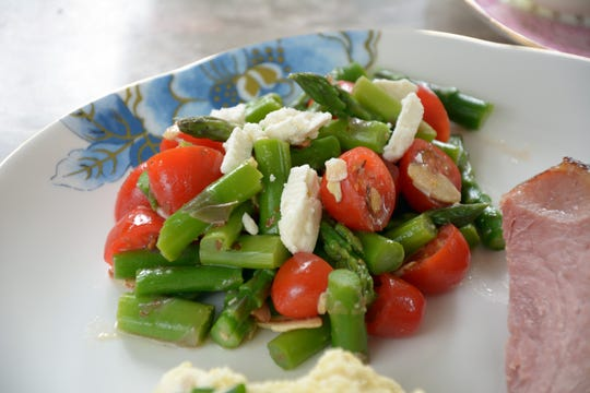 Asparagus is a natural for a spring menu, as in this salad with feta and tomatoes.