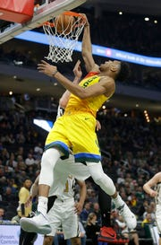 Bucks forward Giannis Antetokounmpo dunks against Hawks center Alex Len during the second half on April 7.