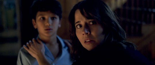 "Linda Cardellini (right, with Roman Christou) plays a mother confronted by ""The Curse of La Llorona."""