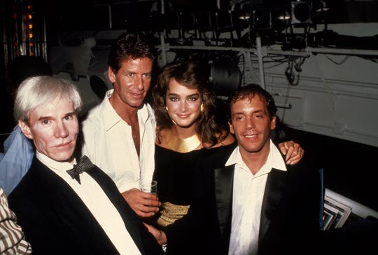 """Studio 54 co-owner Steve Rubell (right, with Andy Warhol, Calvin Klein and Brooke Shields) takes a moment in the legendary New York City nightspot, which is the focus of the documentary """"Studio 54."""""""