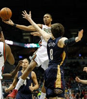 Milwaukee Bucks' Giannis Antetokounmpo goes up for a shot against New Orleans Pelicans' Luke Babbitt in the second period of action at the BMO Harris Bradley Center Monday. February 12, 2014. Giannis, a 19-year-old rookie that season, was a far cry from the player he ultimately became physically.