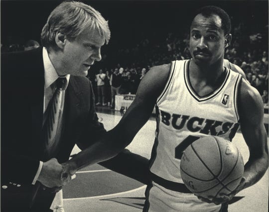 Sidney Moncrief was drafted by the Bucks and spent 10 seasons in Milwaukee. He is shown receiving the game ball from Bucks coach Don Nelson after scoring his 10,000th point in 1987.