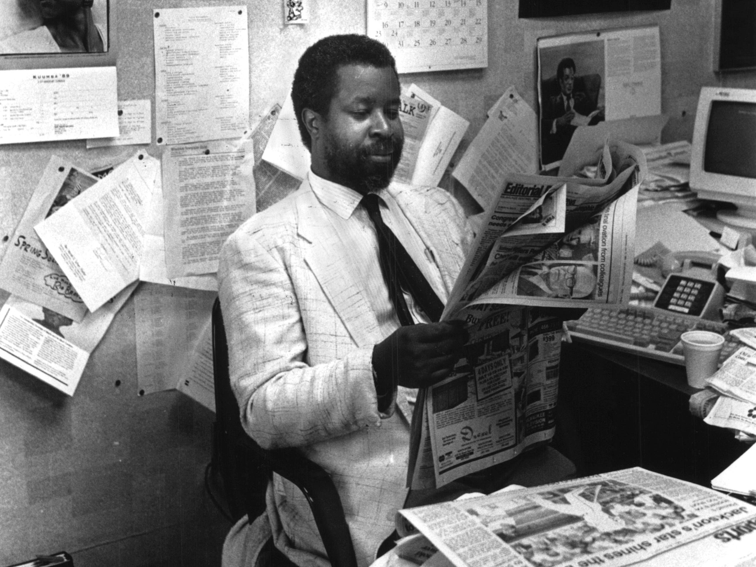 1989: Milwaukee Journal editorial writer Greg Stanford in his office going over the news of the day.