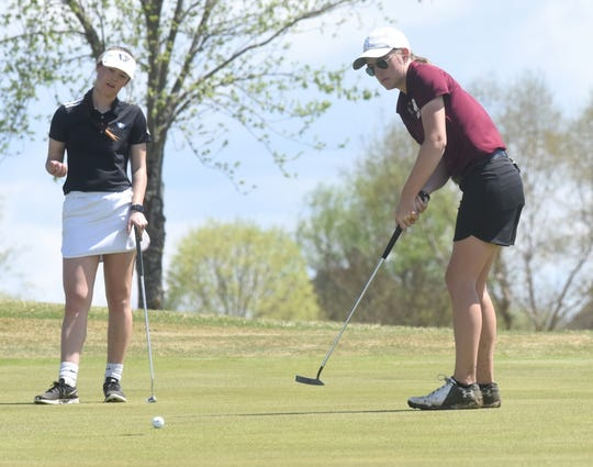 Freed-Hardeman's Chloe Kraus (right) and Williams Baptist's Sidney Bailey watch Kraus's putt on the ninth hole Monday at the Battle at Big Creek tournament, hosted by Williams Baptist.