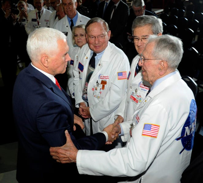Vice President Mike Pence, left, speaks with museum docents at the National Space Council meeting held at the U.S. Space and Rocket Center Tuesday, March 26, 2019, in Huntsville, Ala. Pence is calling for landing astronauts on the moon within five years. (AP Photo/Eric Schultz)