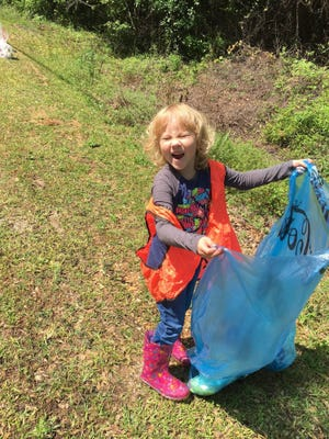 A young volunteer takes part in a Spring Cleanup in Pike Road. The Town of Pike Road's 7th Annual Spring Cleanup is set for April 22-27.