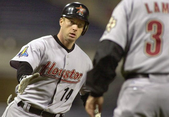 -  -Houston Astros' Morgan Ensberg, left, rounds third to greetings from coach Gene Lamont (3) following a fifth inning solo homer off Pittsburgh Pirates starter Salomon Torres, Monday May 12, 2003, in Pittsburgh.(AP Photo/Gene J. Puskar)
