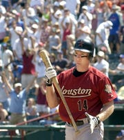 Houston Astros' Morgan Ensberg (14) turns to walk off the field after being called out on strikes with two runners left on base to end the game against the Texas Rangers in Arlington, Texas, Sunday, May 22, 2005.  The Rangers won 2-0. (AP Photo/LM Otero)