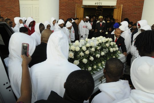 Pallbearers carry the casket holding the body of Glenn Lamar Thomas, also known as Doe B, into True Divine Baptist Church on  Saturday, Jan. 3, 2013, in Montgomery, AL.