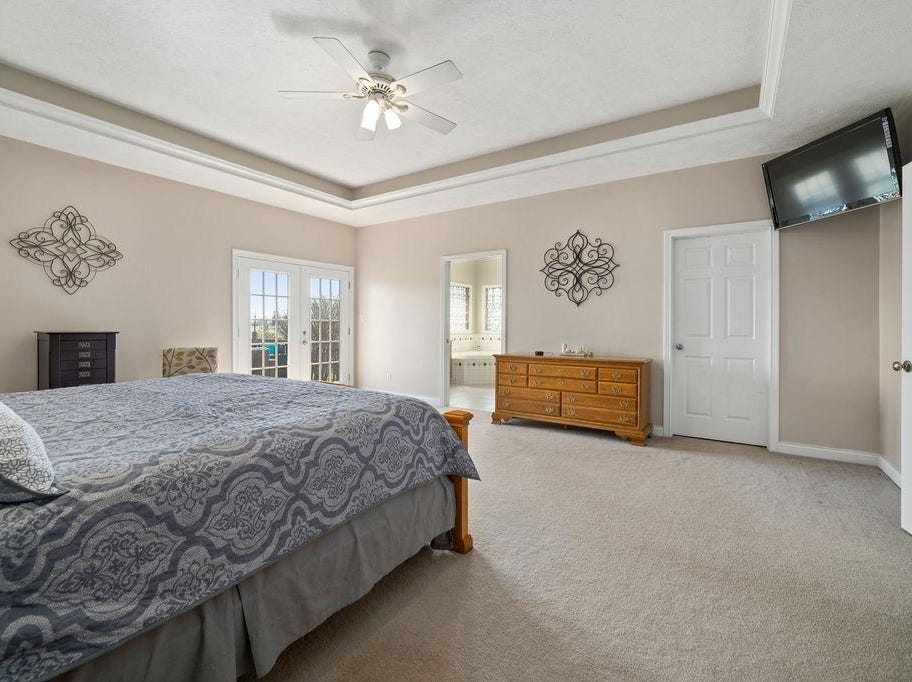 The home at 5959 E. Woodside Road in Albany, Indiana, includes 3 bedrooms, 2.5 bathrooms and a three-car garage.
